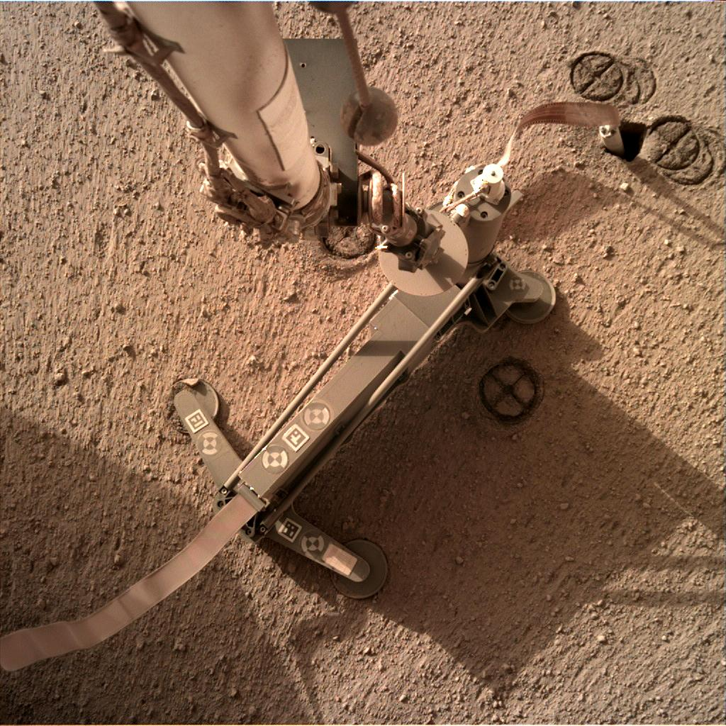 Nasa's Mars lander InSight acquired this image using its Instrument Deployment Camera on Sol 210