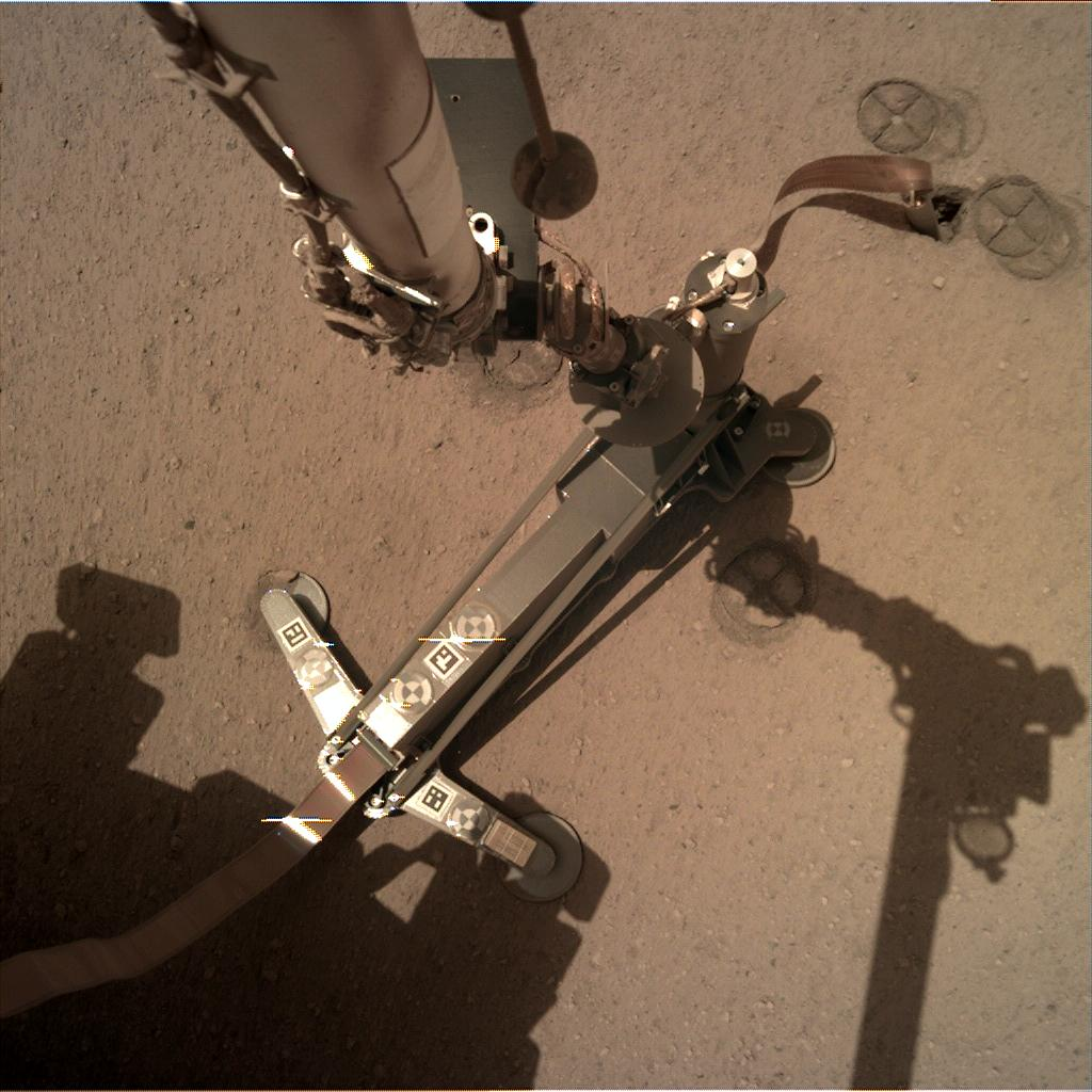 Nasa's Mars lander InSight acquired this image using its Instrument Deployment Camera on Sol 213