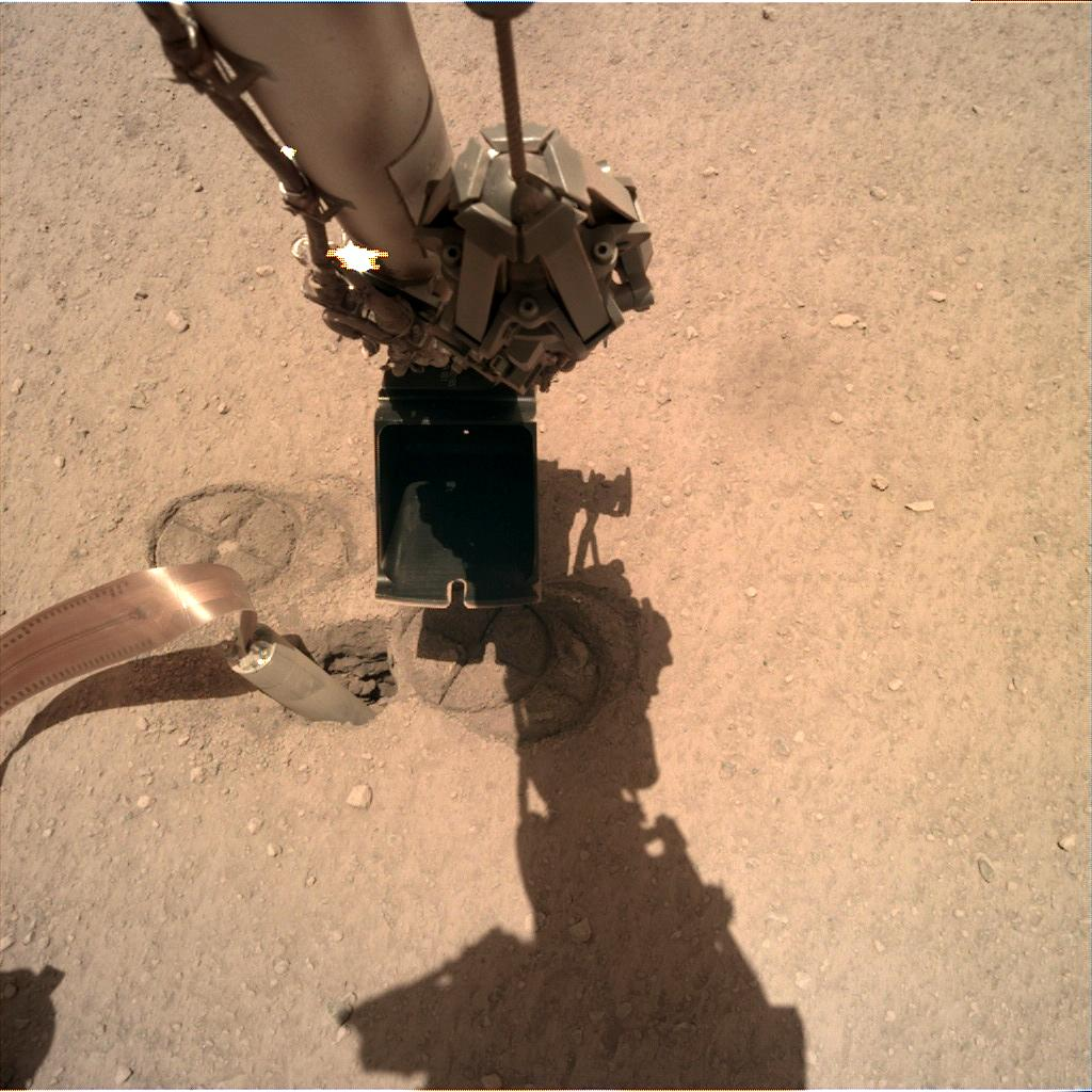 Nasa's Mars lander InSight acquired this image using its Instrument Deployment Camera on Sol 235