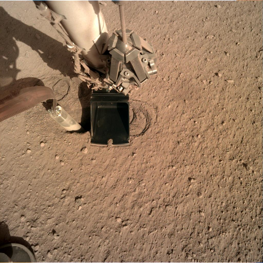 Nasa's Mars lander InSight acquired this image using its Instrument Deployment Camera on Sol 240