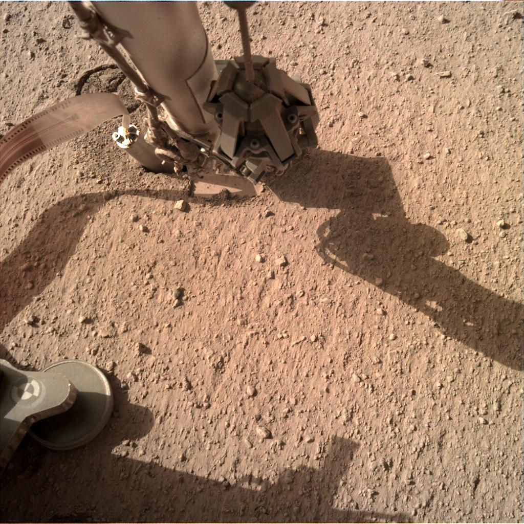 Nasa's Mars lander InSight acquired this image using its Instrument Deployment Camera on Sol 243