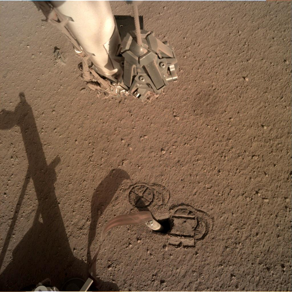 Nasa's Mars lander InSight acquired this image using its Instrument Deployment Camera on Sol 246