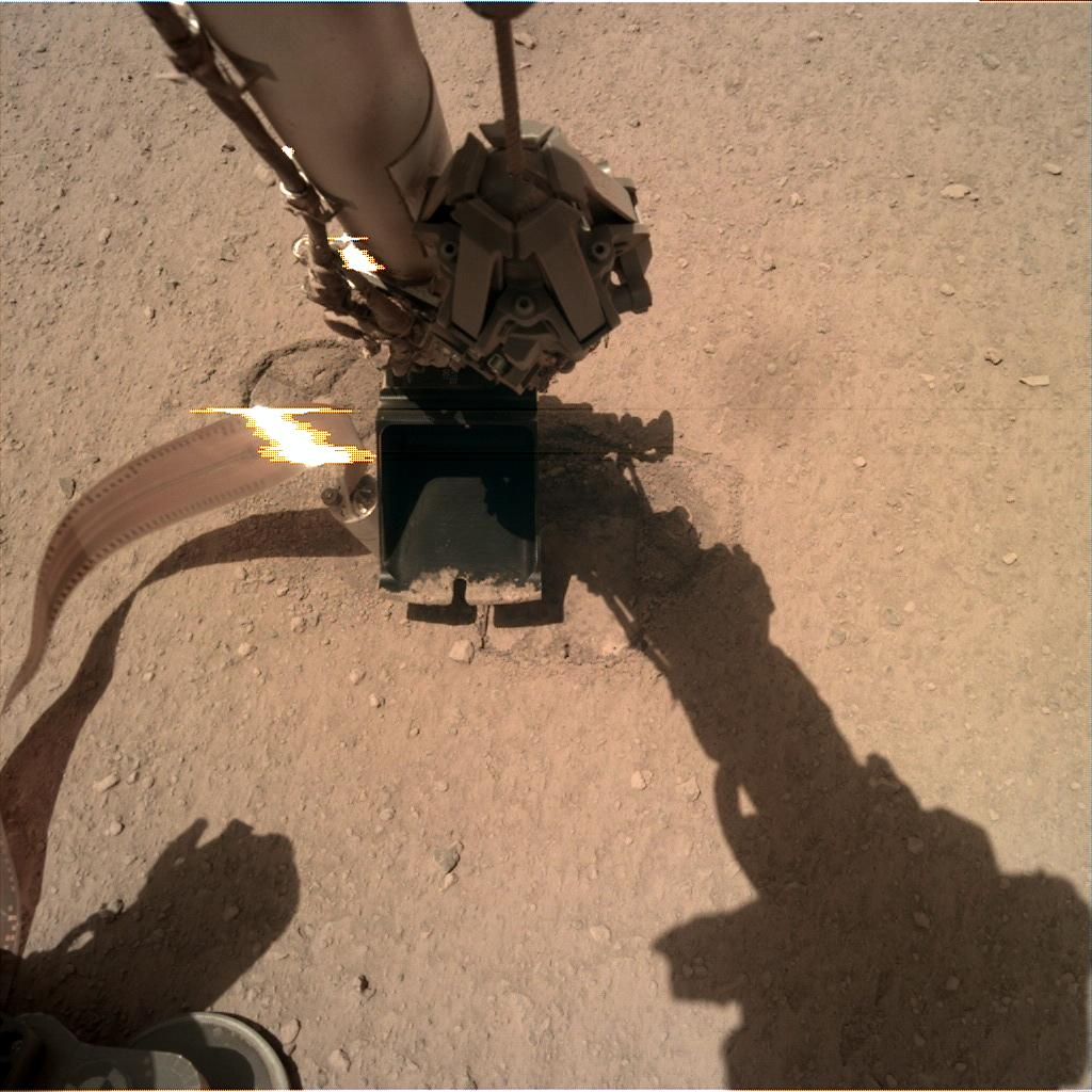 Nasa's Mars lander InSight acquired this image using its Instrument Deployment Camera on Sol 302