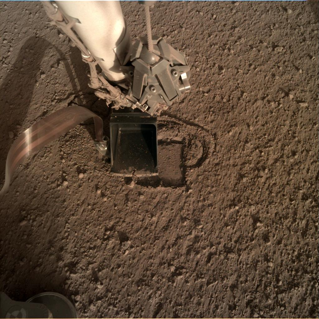Nasa's Mars lander InSight acquired this image using its Instrument Deployment Camera on Sol 315
