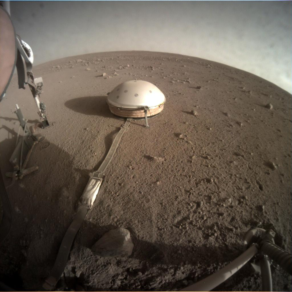 Nasa's Mars lander InSight acquired this image using its Instrument Context Camera on Sol 318