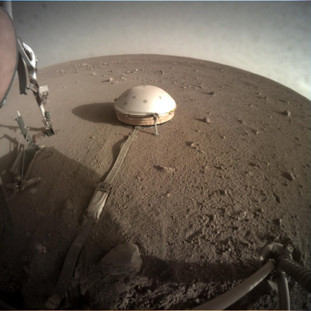 Nasa's Mars lander InSight acquired this image using its Instrument Context Camera on Sol 322