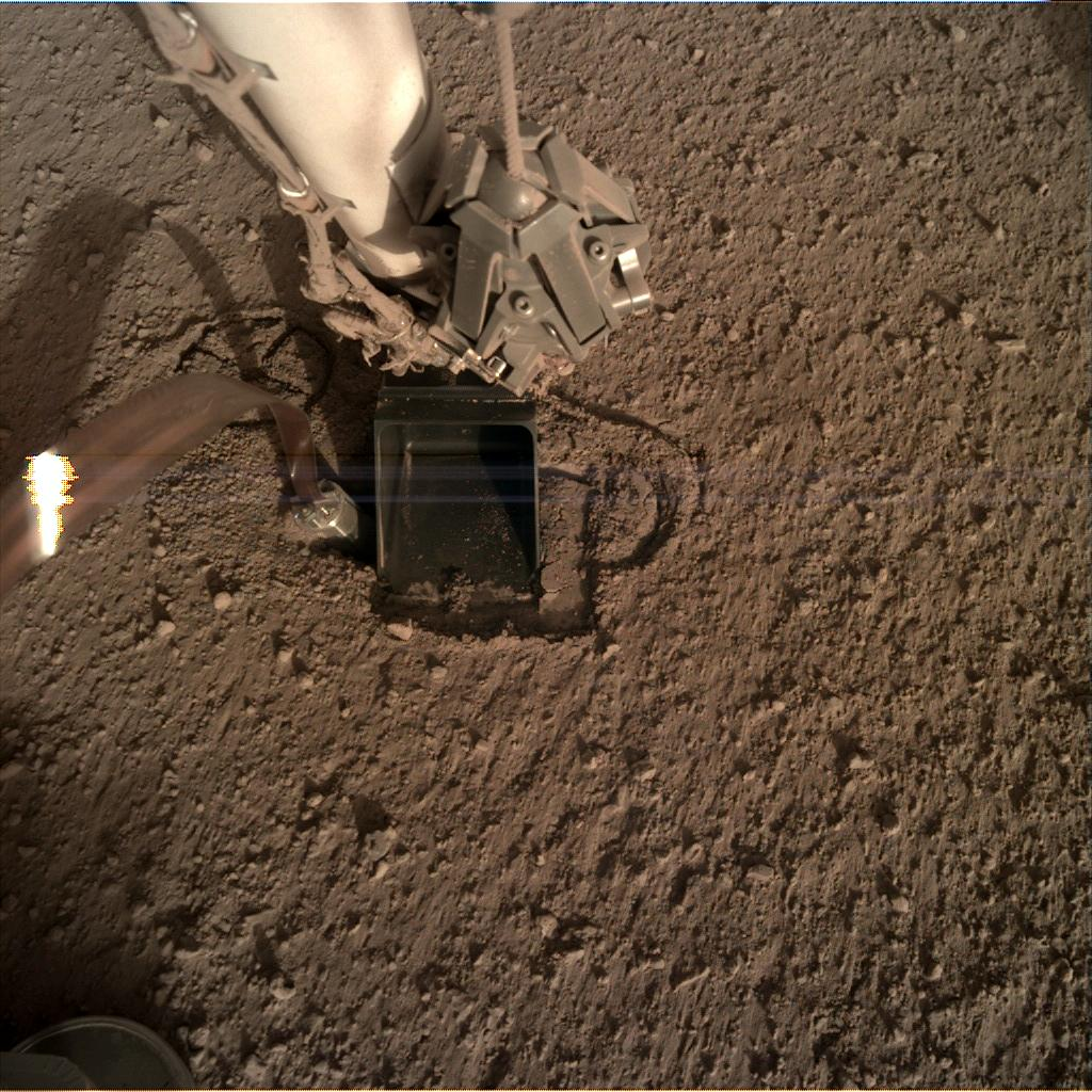 Nasa's Mars lander InSight acquired this image using its Instrument Deployment Camera on Sol 322
