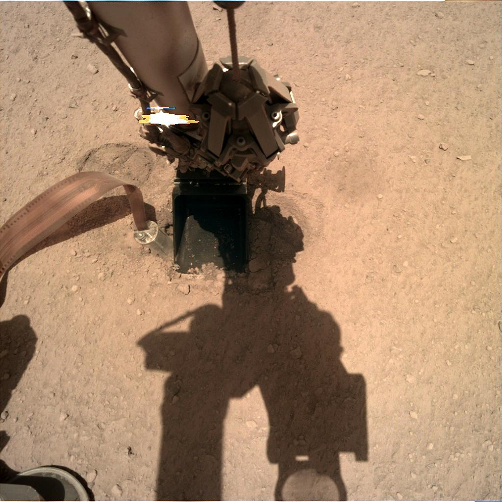 Nasa's Mars lander InSight acquired this image using its Instrument Deployment Camera on Sol 325