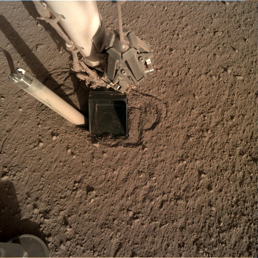 Nasa's Mars lander InSight acquired this image using its Instrument Deployment Camera on Sol 329
