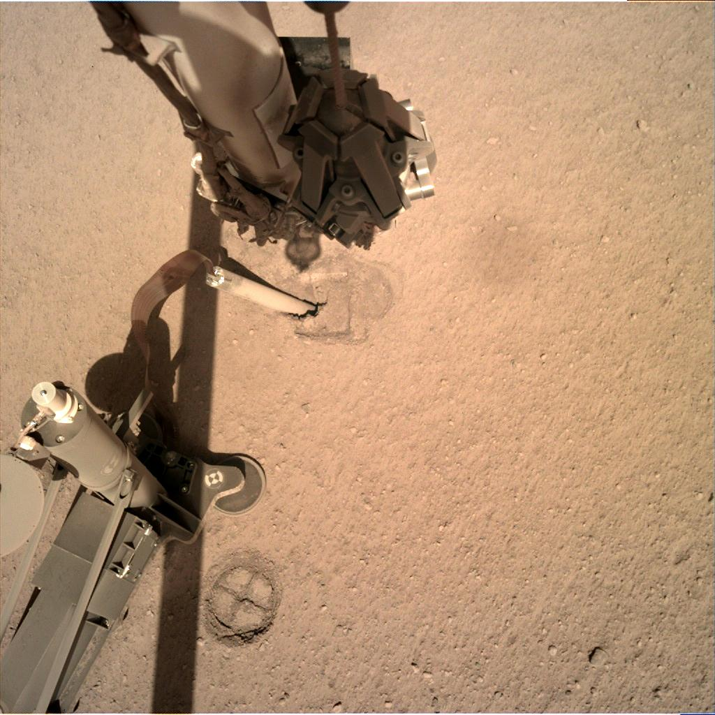 Nasa's Mars lander InSight acquired this image using its Instrument Deployment Camera on Sol 332