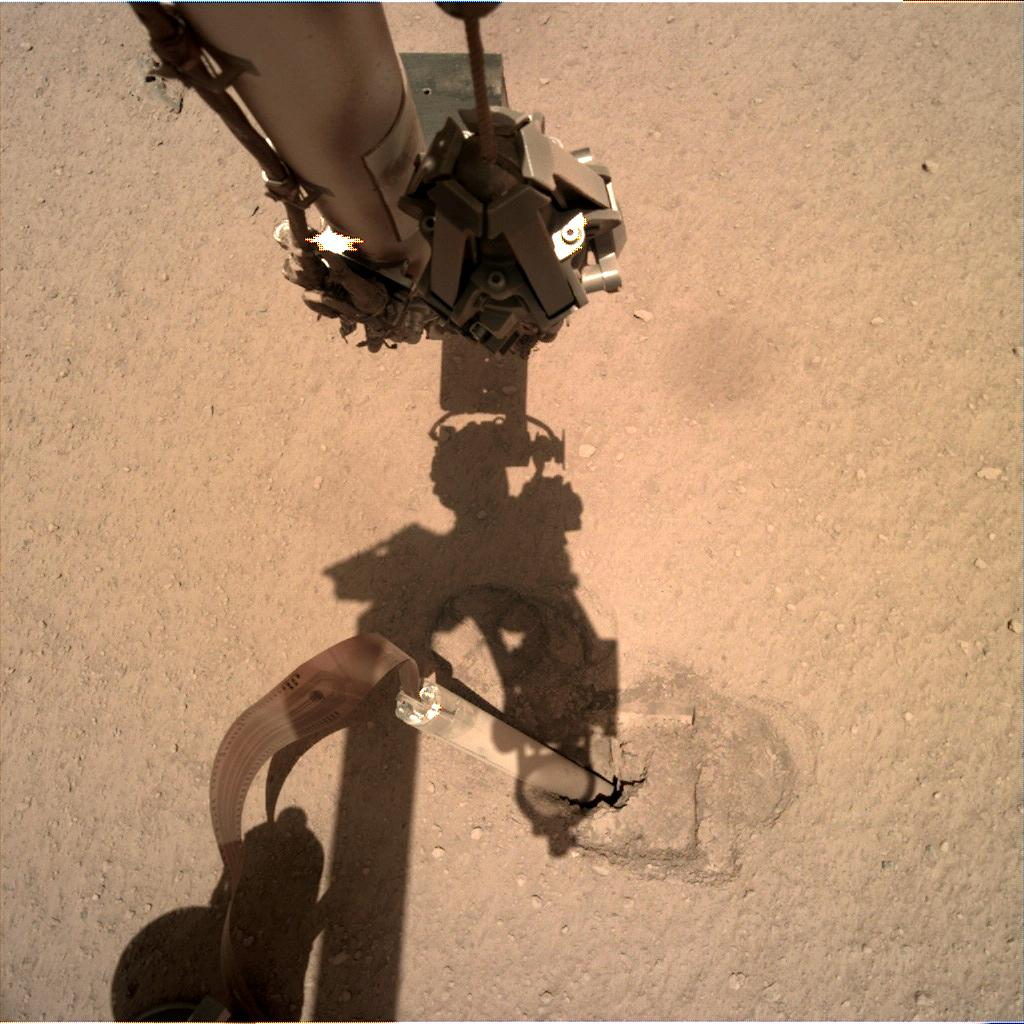 Nasa's Mars lander InSight acquired this image using its Instrument Deployment Camera on Sol 333