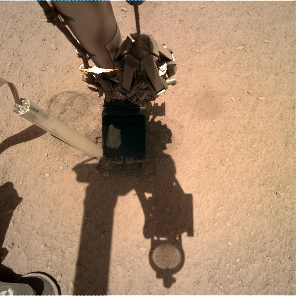 Nasa's Mars lander InSight acquired this image using its Instrument Deployment Camera on Sol 335