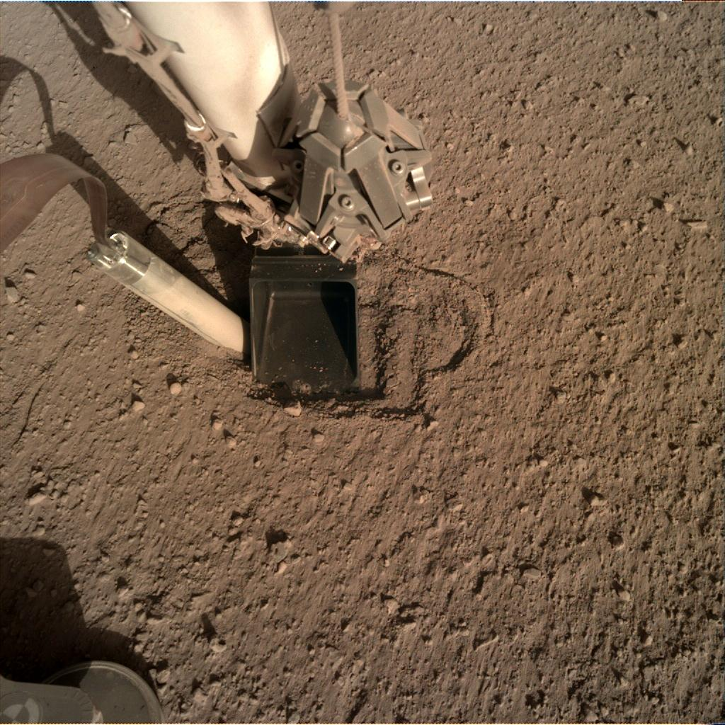 Nasa's Mars lander InSight acquired this image using its Instrument Deployment Camera on Sol 355