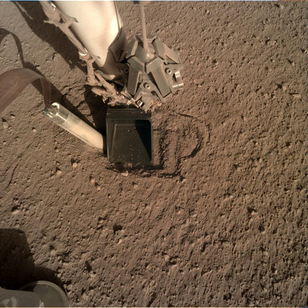 Nasa's Mars lander InSight acquired this image using its Instrument Deployment Camera on Sol 370