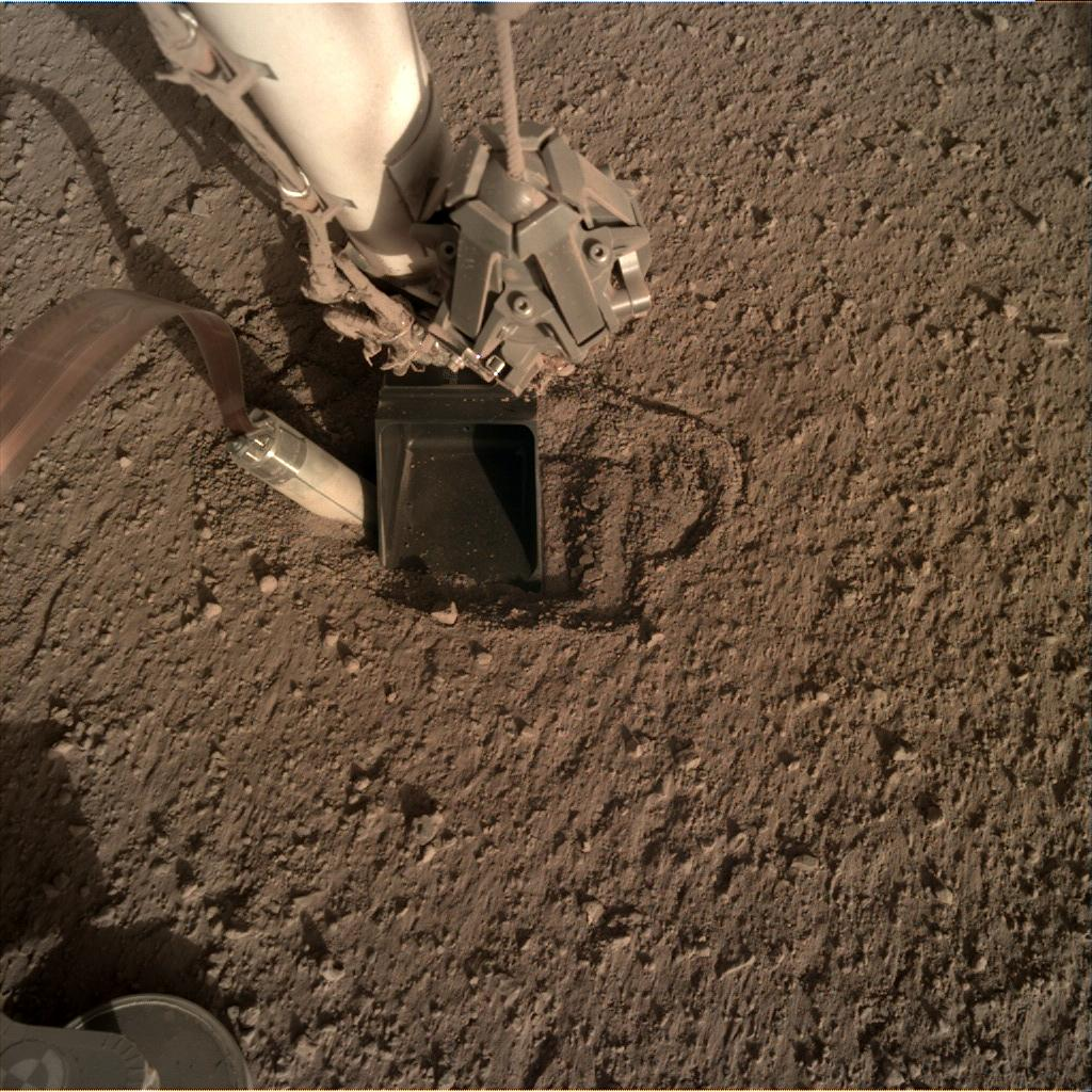 Nasa's Mars lander InSight acquired this image using its Instrument Deployment Camera on Sol 373