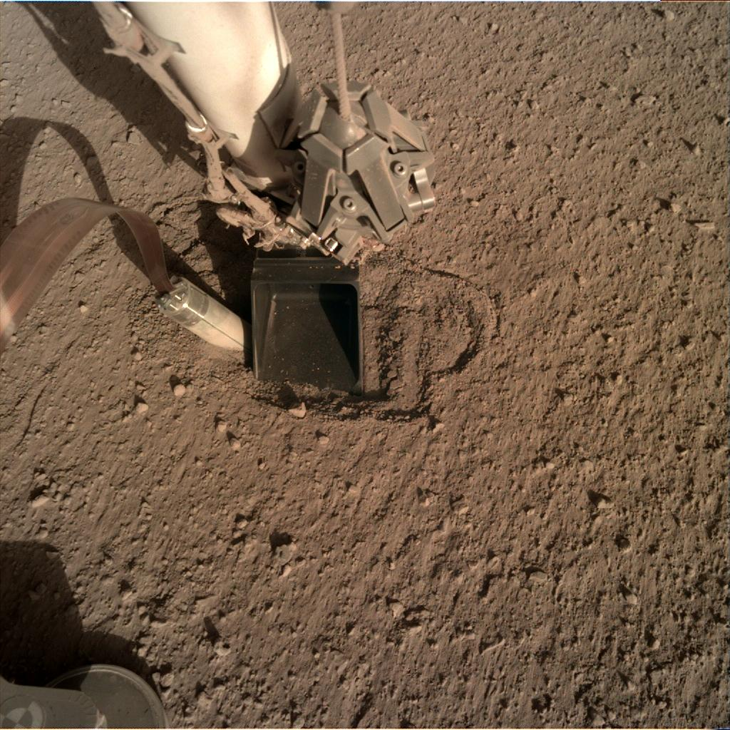 Nasa's Mars lander InSight acquired this image using its Instrument Deployment Camera on Sol 376