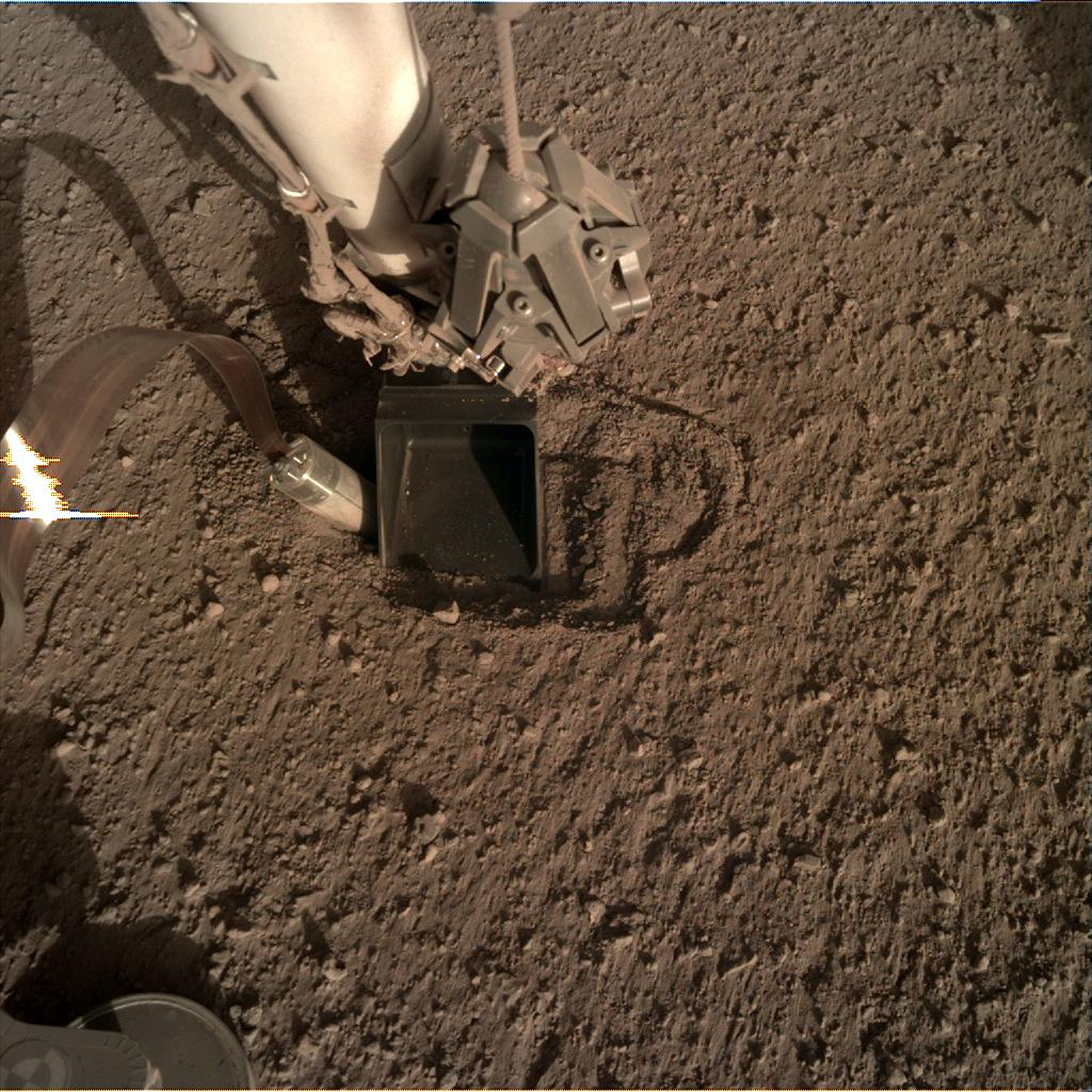 Nasa's Mars lander InSight acquired this image using its Instrument Deployment Camera on Sol 380