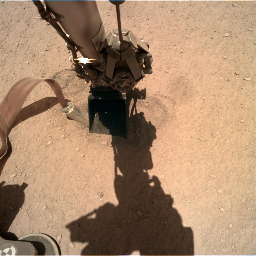 Nasa's Mars lander InSight acquired this image using its Instrument Deployment Camera on Sol 382
