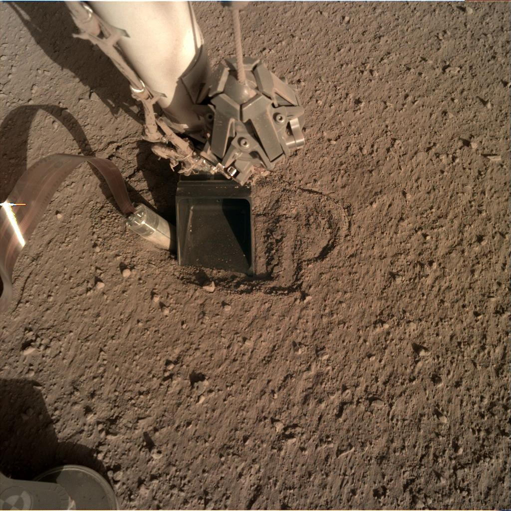 Nasa's Mars lander InSight acquired this image using its Instrument Deployment Camera on Sol 383