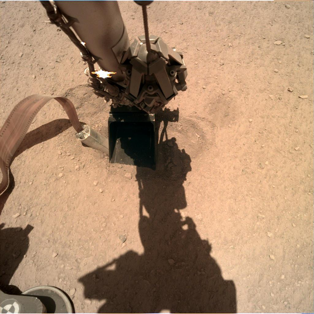 Nasa's Mars lander InSight acquired this image using its Instrument Deployment Camera on Sol 384