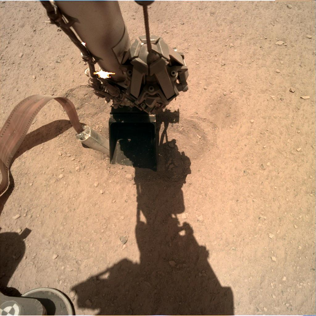 Nasa's Mars lander InSight acquired this image using its Instrument Deployment Camera on Sol 390