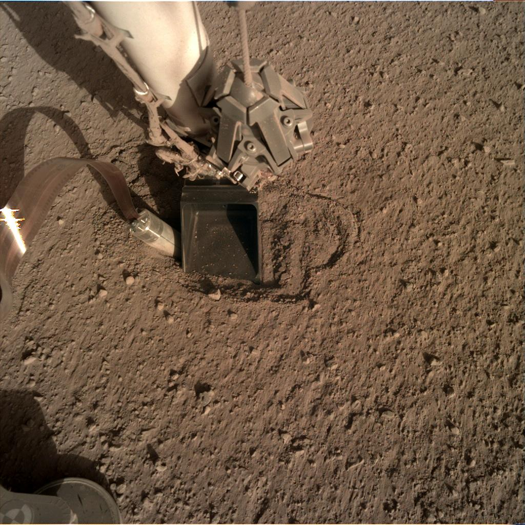 Nasa's Mars lander InSight acquired this image using its Instrument Deployment Camera on Sol 391