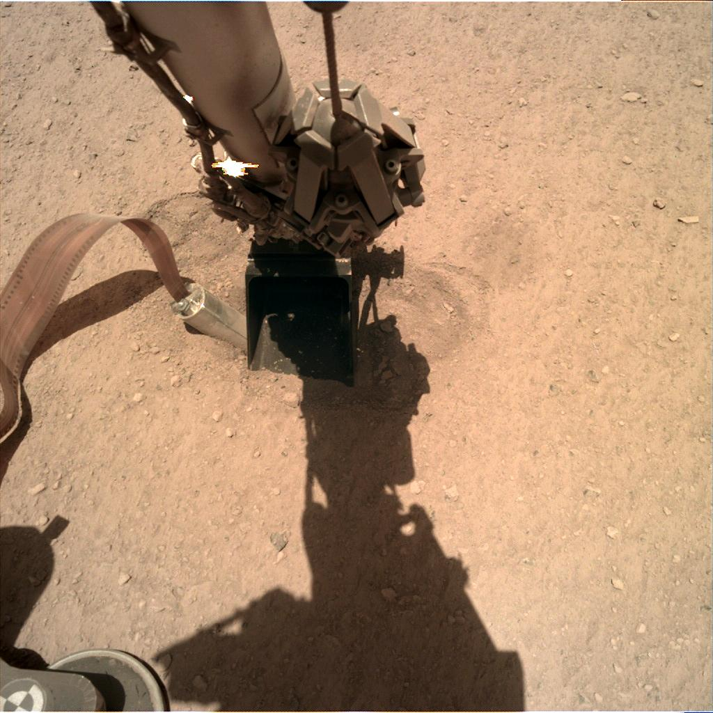 Nasa's Mars lander InSight acquired this image using its Instrument Deployment Camera on Sol 392
