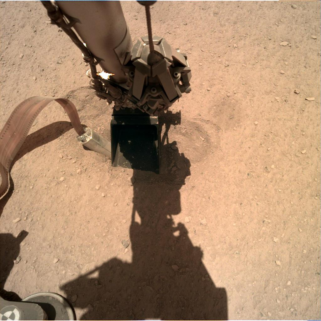 Nasa's Mars lander InSight acquired this image using its Instrument Deployment Camera on Sol 393