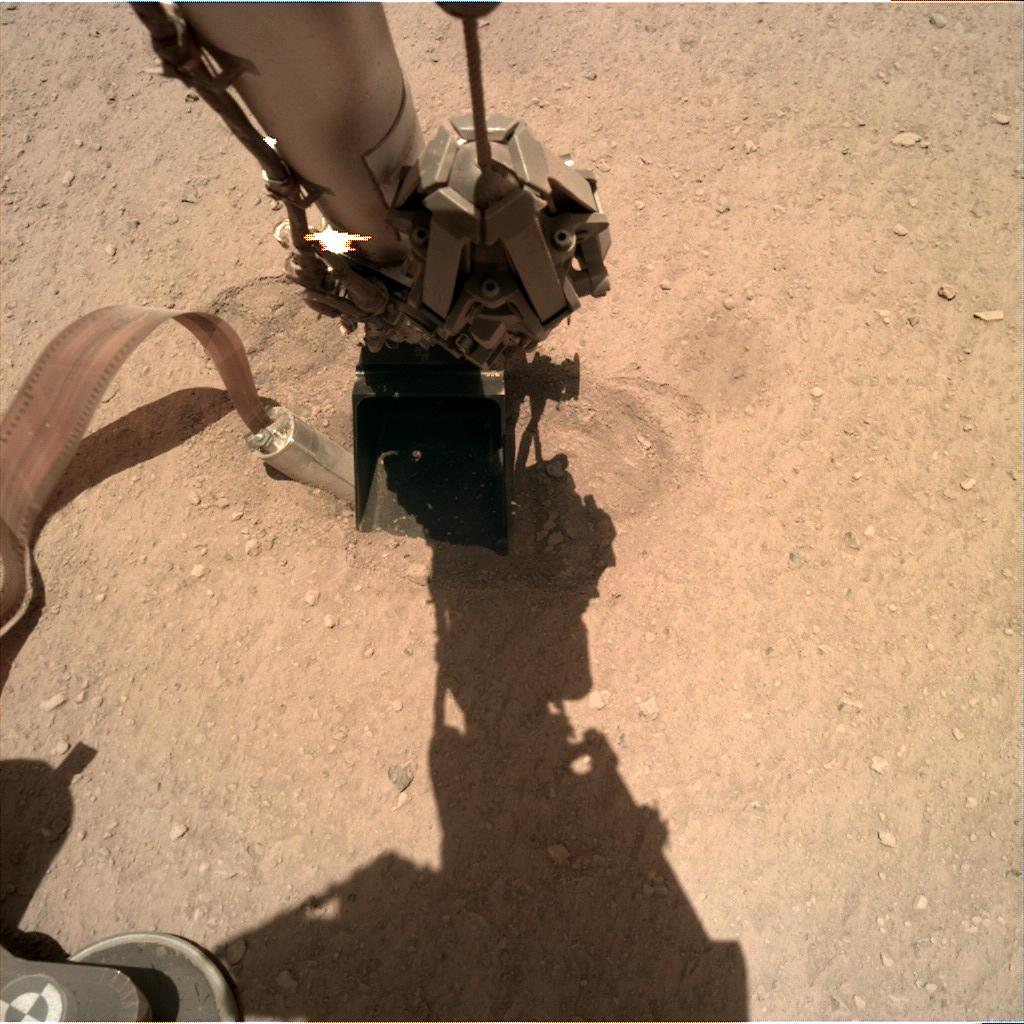 Nasa's Mars lander InSight acquired this image using its Instrument Deployment Camera on Sol 394