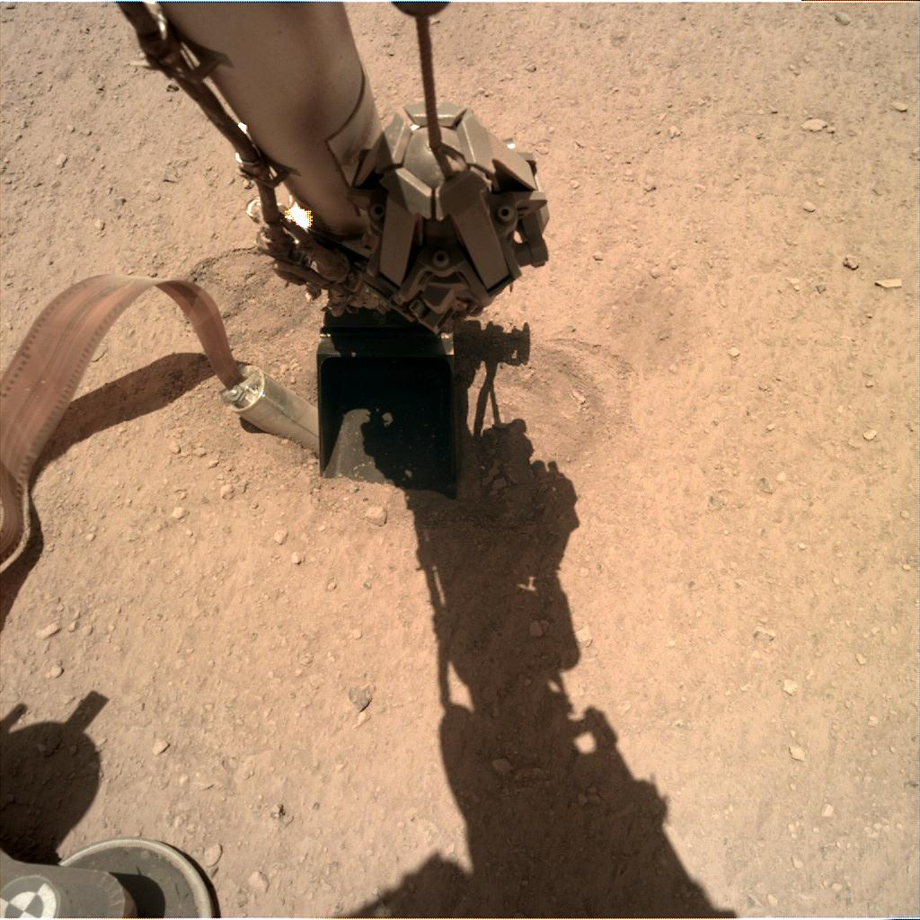 Nasa's Mars lander InSight acquired this image using its Instrument Deployment Camera on Sol 395