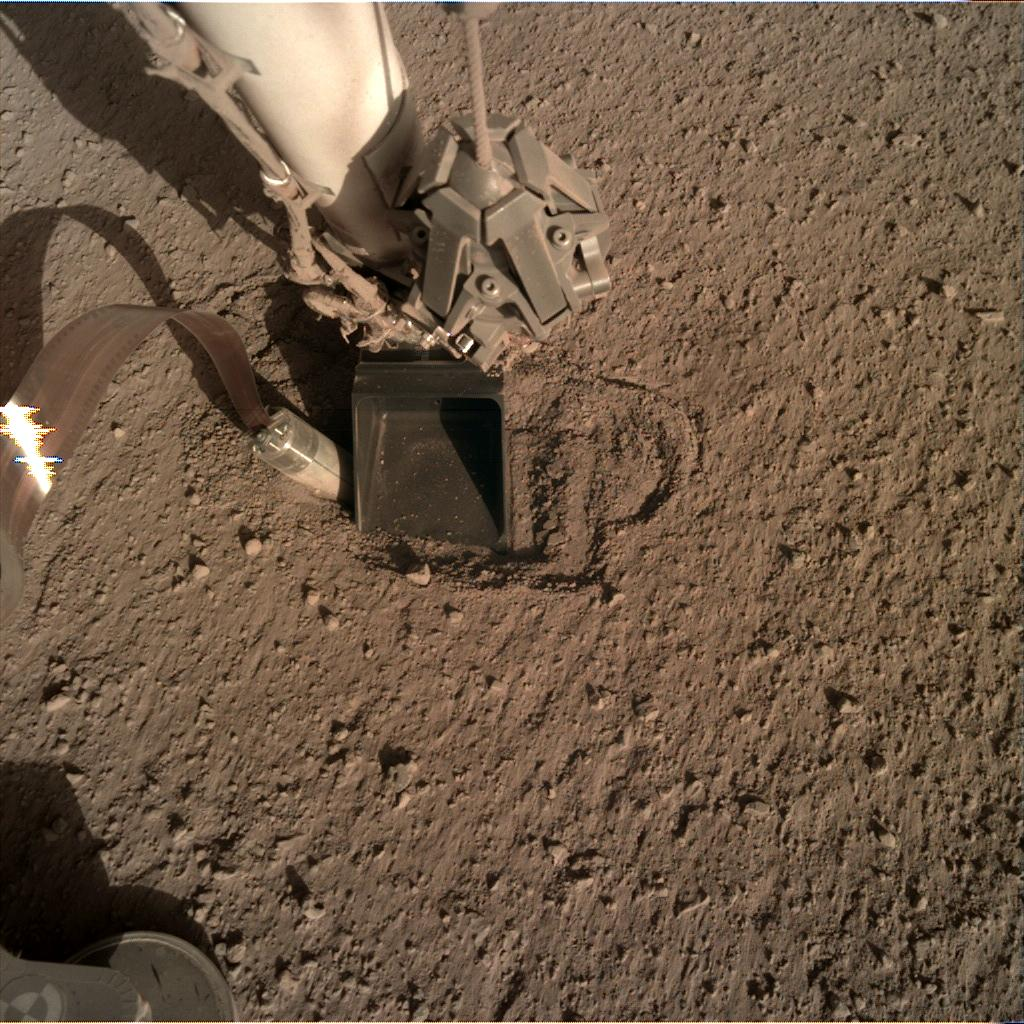 Nasa's Mars lander InSight acquired this image using its Instrument Deployment Camera on Sol 396