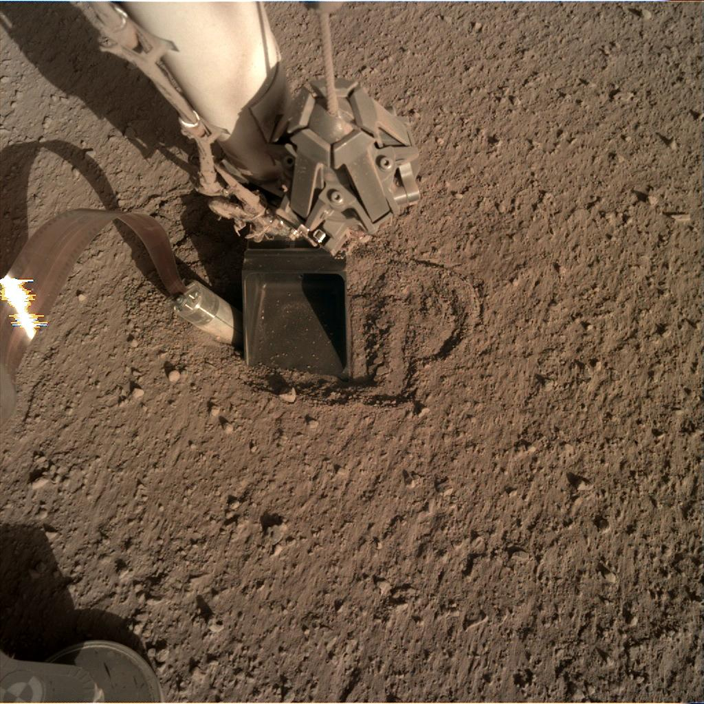 Nasa's Mars lander InSight acquired this image using its Instrument Deployment Camera on Sol 398