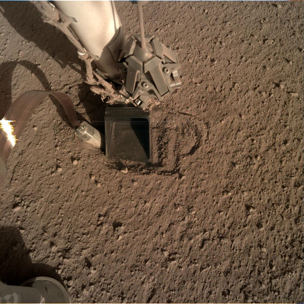 Nasa's Mars lander InSight acquired this image using its Instrument Deployment Camera on Sol 399