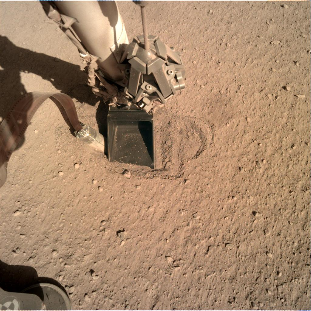 Nasa's Mars lander InSight acquired this image using its Instrument Deployment Camera on Sol 400
