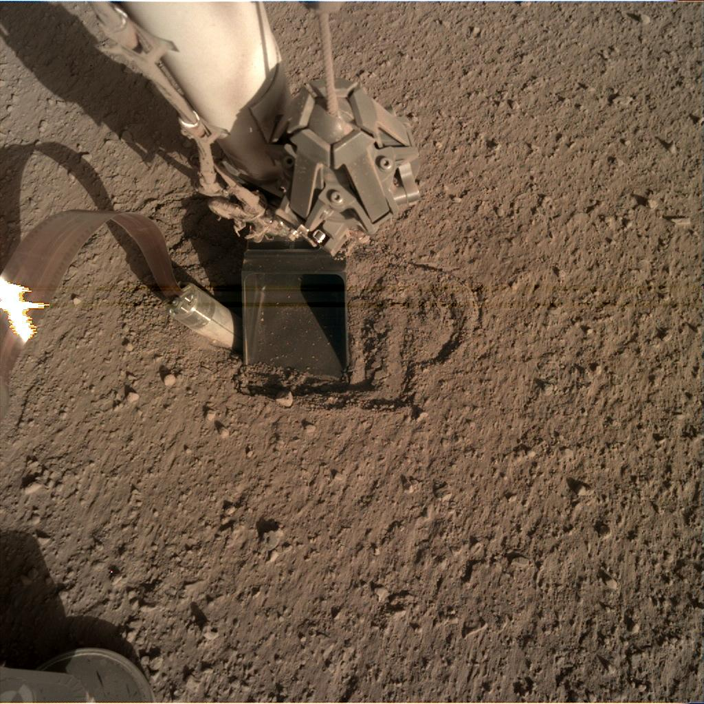 Nasa's Mars lander InSight acquired this image using its Instrument Deployment Camera on Sol 401