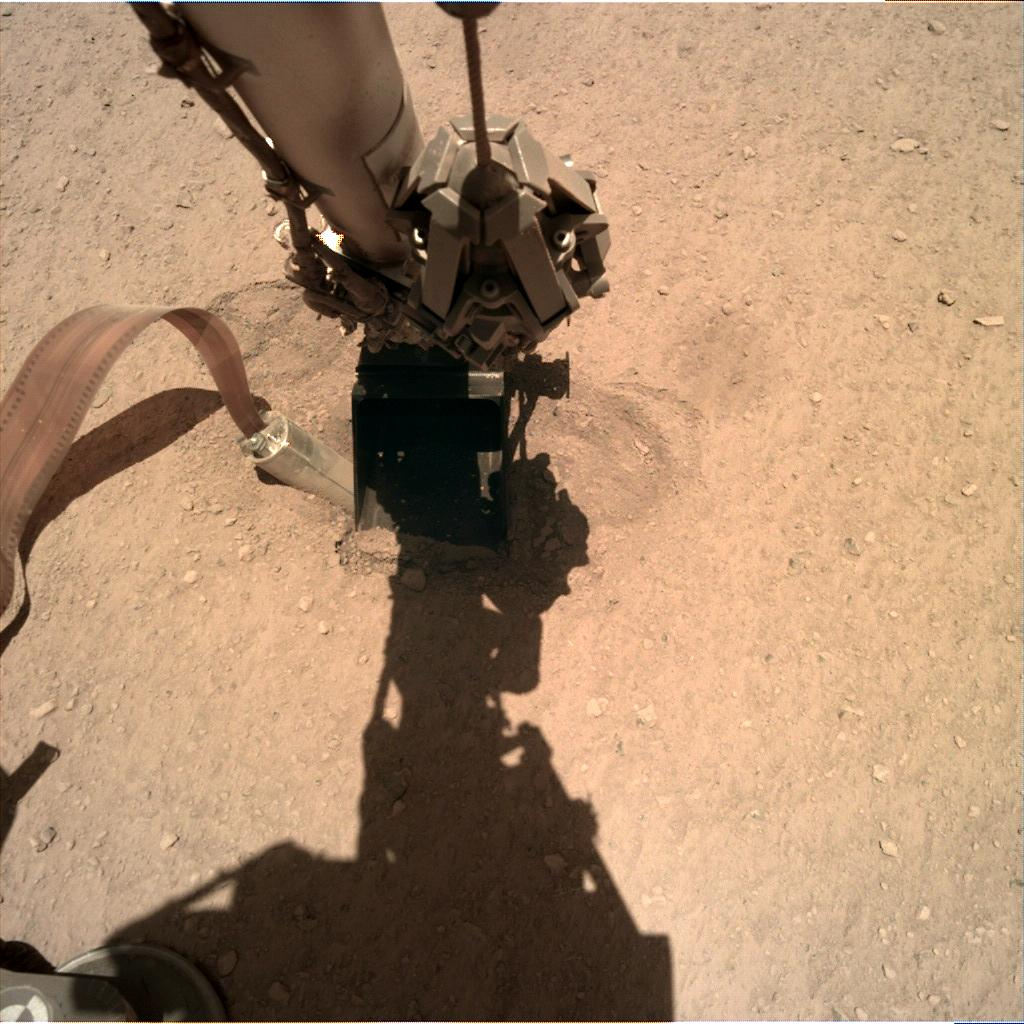 Nasa's Mars lander InSight acquired this image using its Instrument Deployment Camera on Sol 402