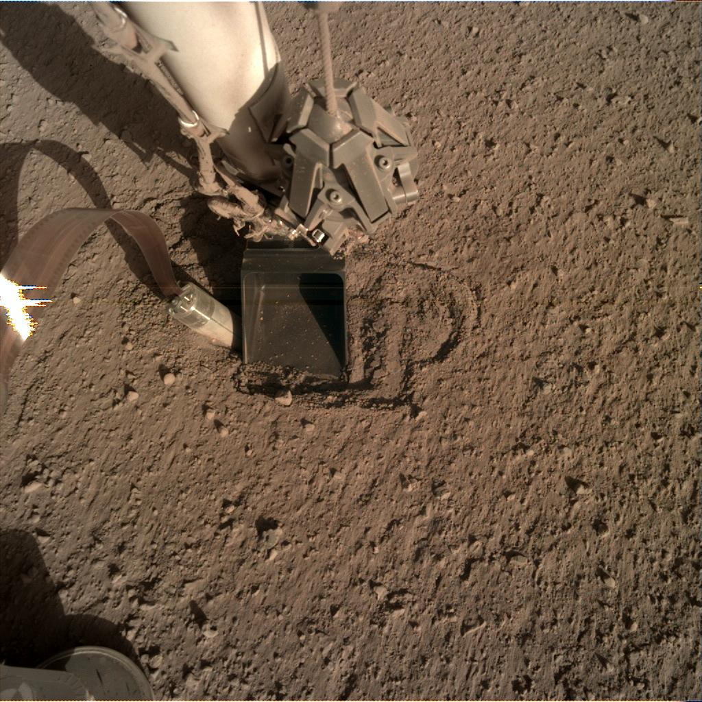 Nasa's Mars lander InSight acquired this image using its Instrument Deployment Camera on Sol 403