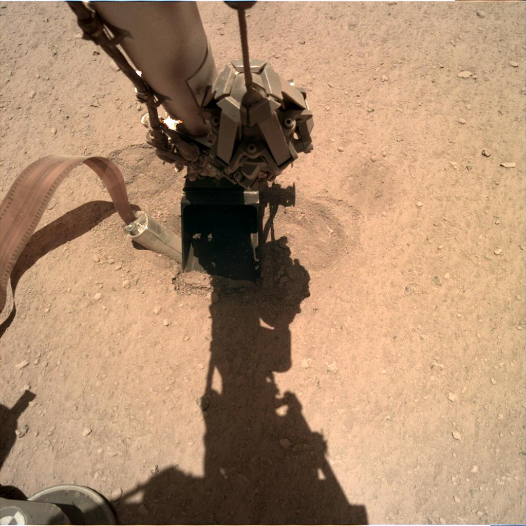 Nasa's Mars lander InSight acquired this image using its Instrument Deployment Camera on Sol 404