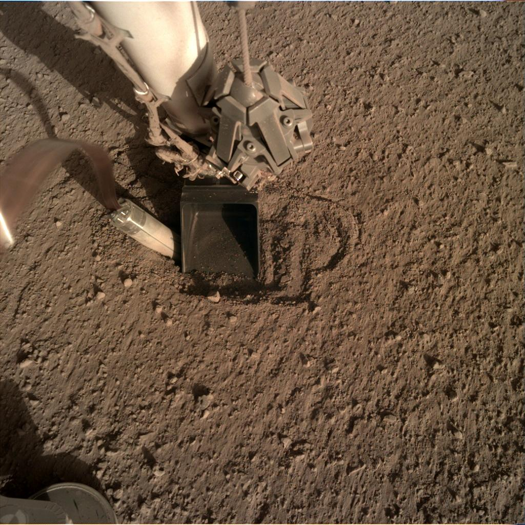 Nasa's Mars lander InSight acquired this image using its Instrument Deployment Camera on Sol 407
