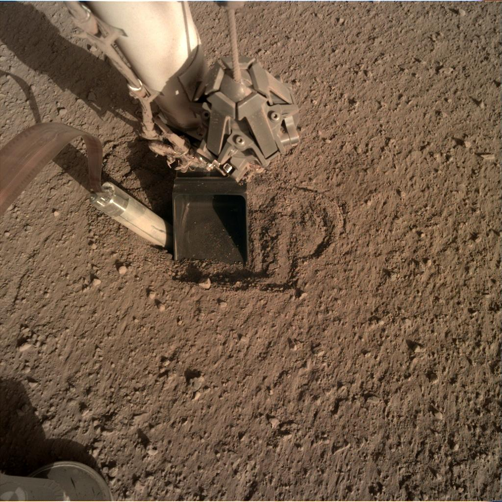 Nasa's Mars lander InSight acquired this image using its Instrument Deployment Camera on Sol 410