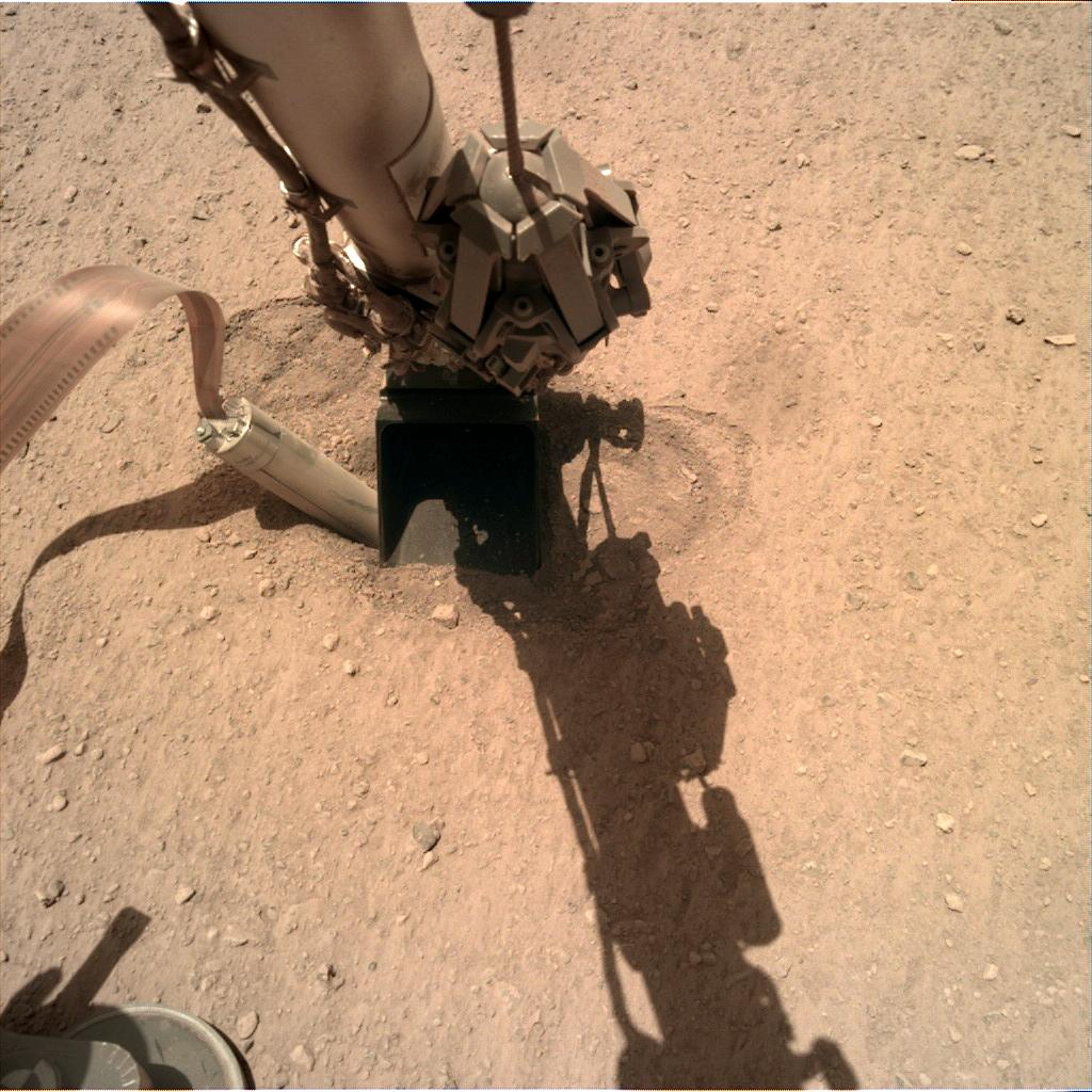 Nasa's Mars lander InSight acquired this image using its Instrument Deployment Camera on Sol 413