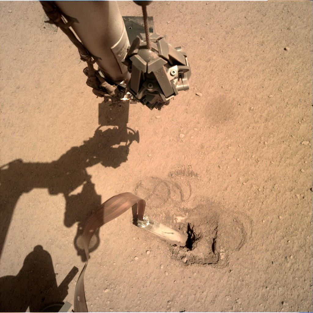 Nasa's Mars lander InSight acquired this image using its Instrument Deployment Camera on Sol 418