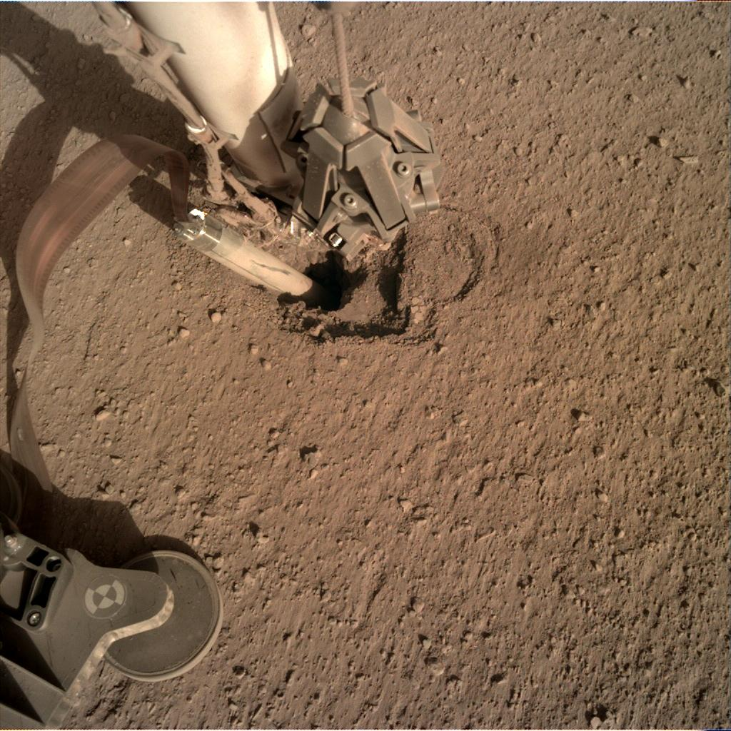 Nasa's Mars lander InSight acquired this image using its Instrument Deployment Camera on Sol 420