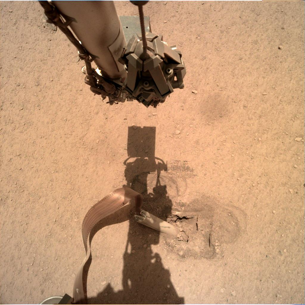 Nasa's Mars lander InSight acquired this image using its Instrument Deployment Camera on Sol 422