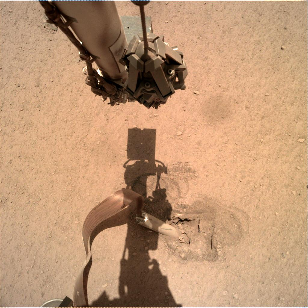 Nasa's Mars lander InSight acquired this image using its Instrument Deployment Camera on Sol 426