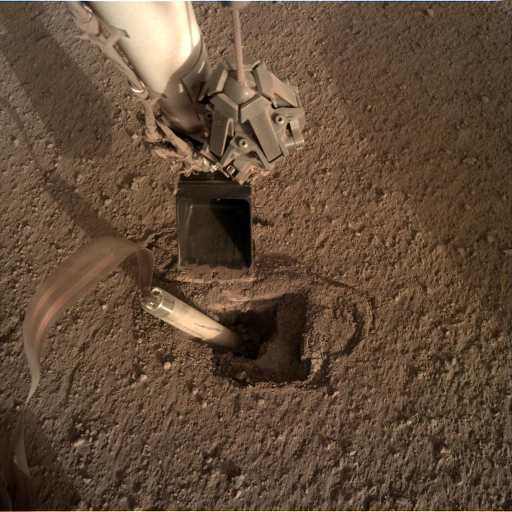 Nasa's Mars lander InSight acquired this image using its Instrument Deployment Camera on Sol 427