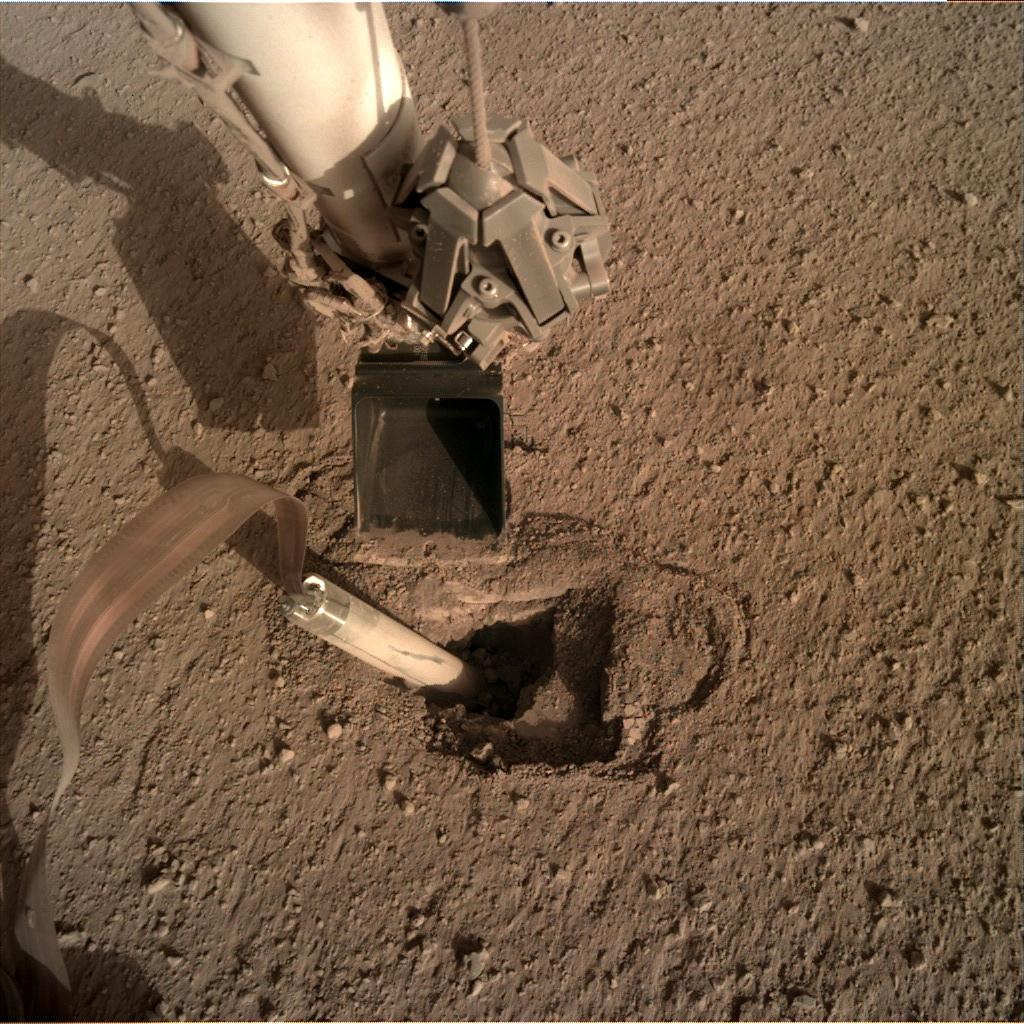 Nasa's Mars lander InSight acquired this image using its Instrument Deployment Camera on Sol 428