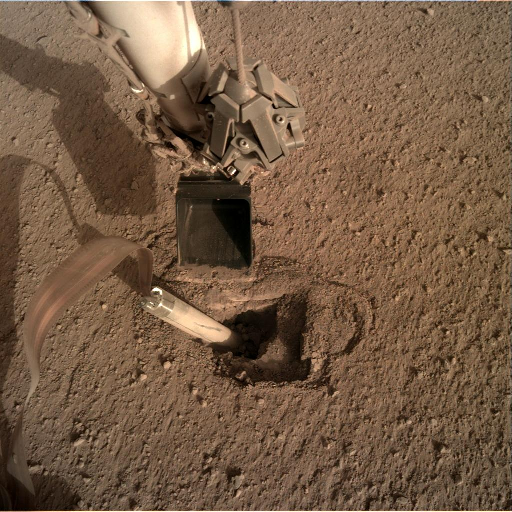 Nasa's Mars lander InSight acquired this image using its Instrument Deployment Camera on Sol 432