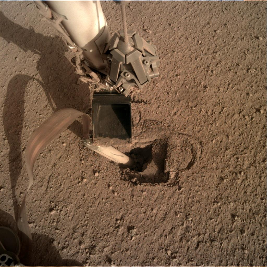 Nasa's Mars lander InSight acquired this image using its Instrument Deployment Camera on Sol 434
