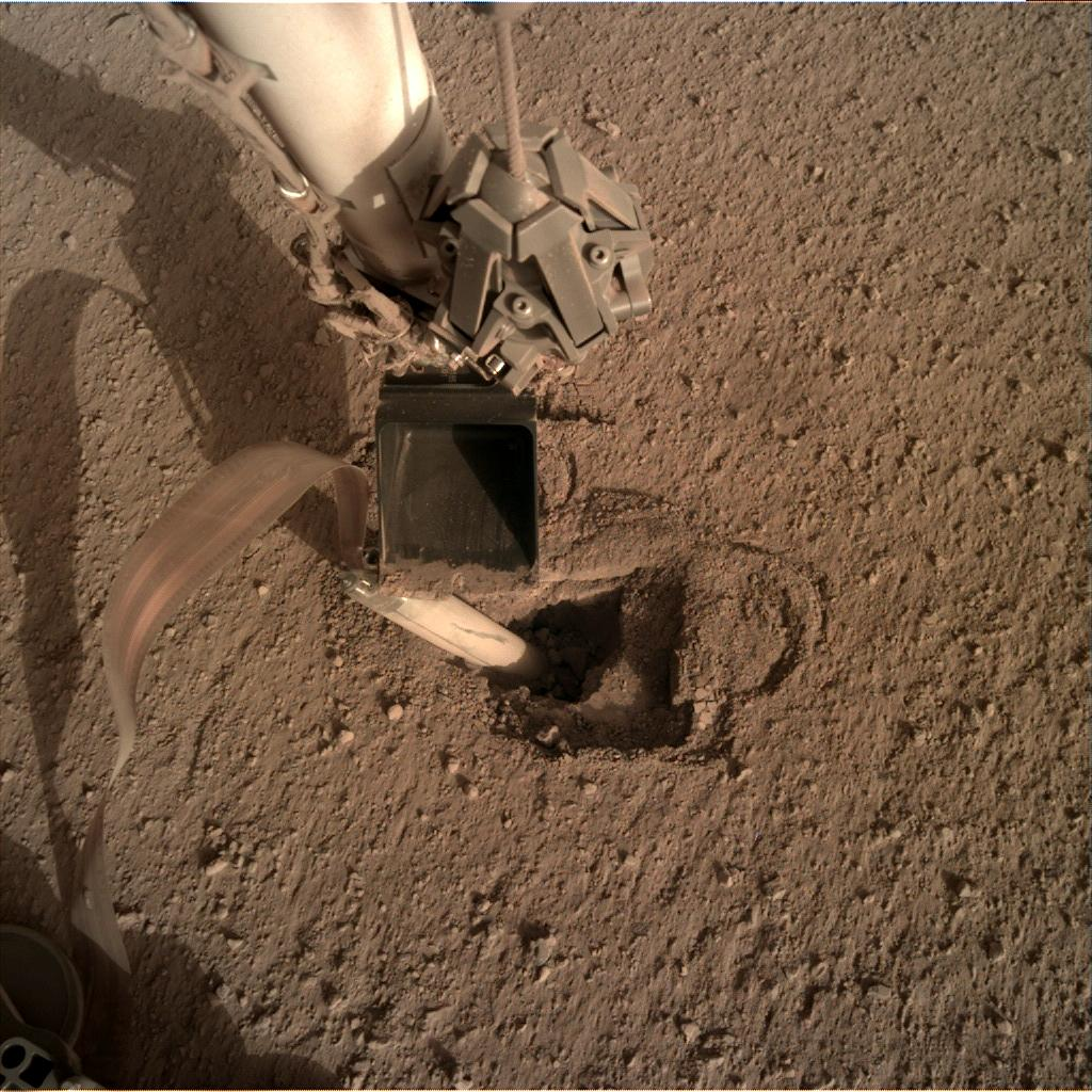 Nasa's Mars lander InSight acquired this image using its Instrument Deployment Camera on Sol 435